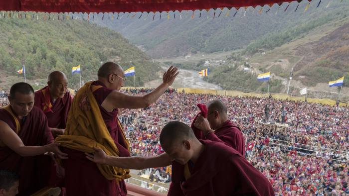 The Dalai Lama waves to supporters at a Buddhist monastery in the Himalayan Indian state of Arunachal Pradesh this month © AP