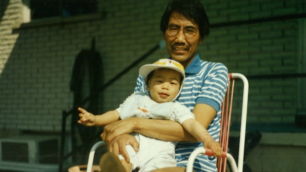 Rignam as a baby with his father Tsering Wangkhang in the backyard of their home in Belleville, Ontario. (Wangkhang family)
