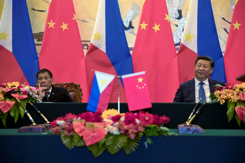 In this Thursday, Oct. 20, 2016 photo, Philippine President Rodrigo Duterte, left, and Chinese President Xi Jinping attend a signing ceremony in Beijing. AP/Ng Han Guan, Pool, File