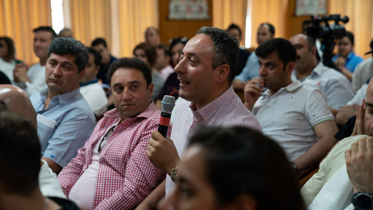 A member of the audience asking His Holiness the Dalai Lama during his meeting with members of Iranian Impacters Club at his residence in Dharamsala, HP, India on June 7, 2019. Photo by Tenzin Choejor