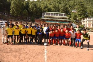 Speaker Pema Jungney and Health Kalon Choekyong Wangchuk with Dhasa United FC and DYSA Mundgod before the first match of the tournament kicked off. Photo/Tenzin Jigme/CTA