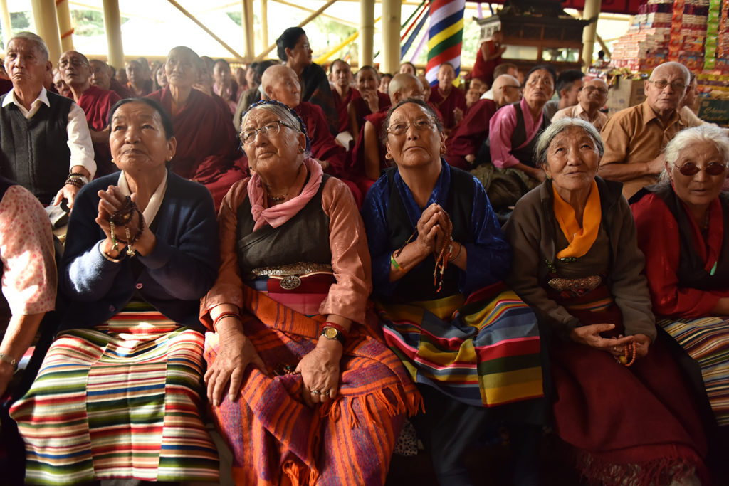 Elderly Tibetans rejoice to watch the live telecast of the Long Life Prayer Ceremony through the television set, 13 September 2019. Photo/Tenzin Jigme Taydeh/CTA