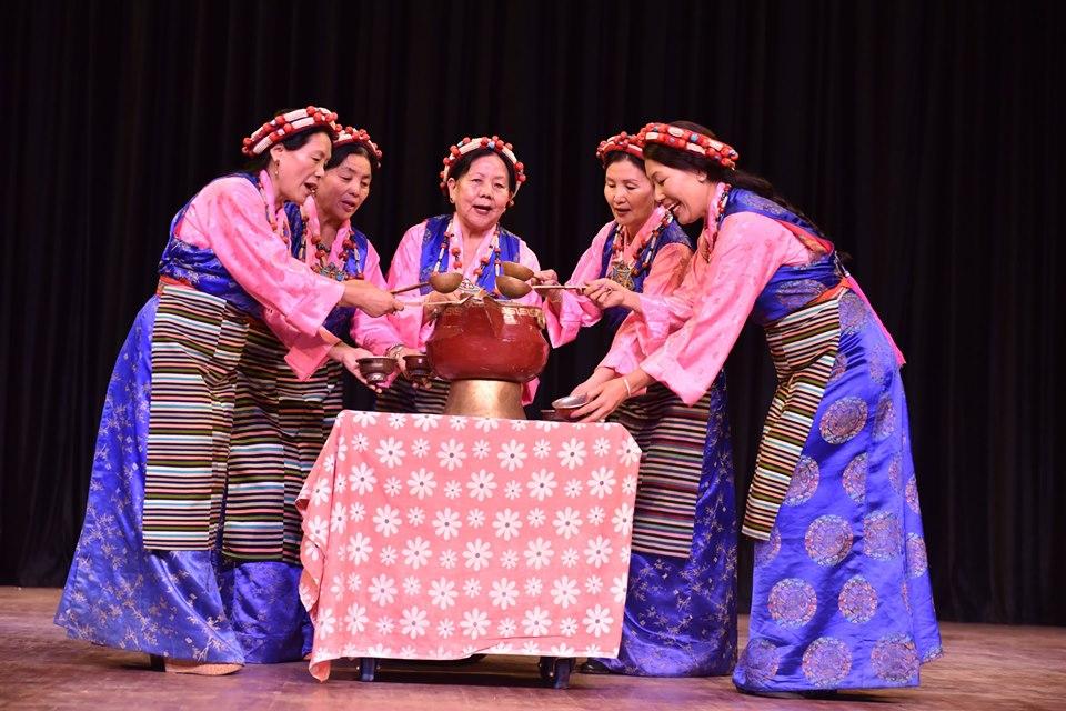 Former Tipa artistes offering (Chhang) Tibetan wine while singing Tibetan folk song. Photo|Tenzin Jigme|CTA
