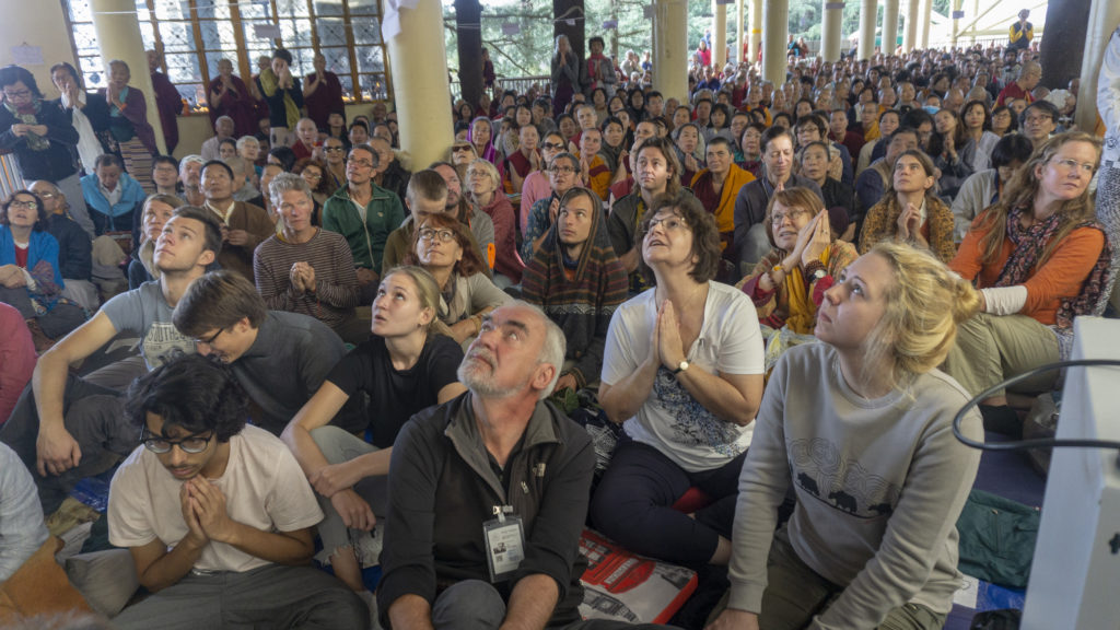 Devotees looking at the screening of His Holiness teaching. Photo/Tenzin Jigme/CTA