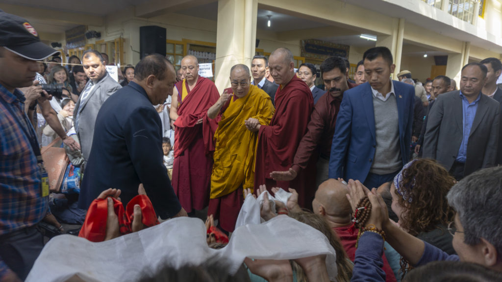His Holiness bidding goodbye to the devotees as he proceeds towards his residence. Photo/Tenzin Jigme/CTA