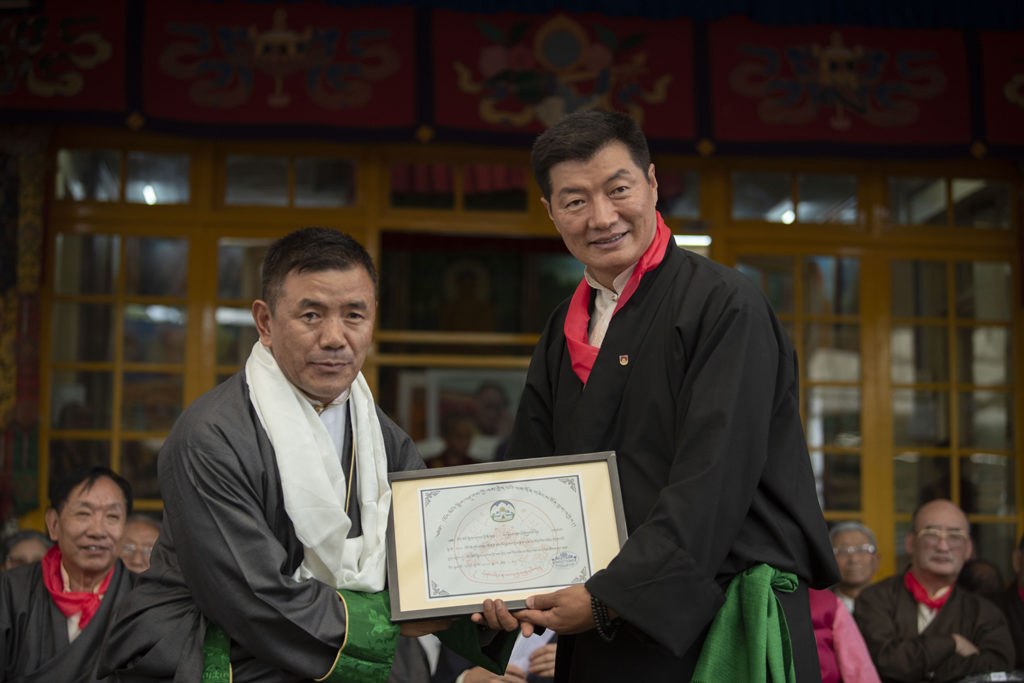 CTA President Dr. Lobsang Sangay presents a recognition certificate to distinctive CTA official Dhondup Tsering for his exemplary service and contribution, at the Tsuglakhang, in Mcleod Ganj, on 6 July 2019. Photo|Tenzin Jigme Taydeh|CTA