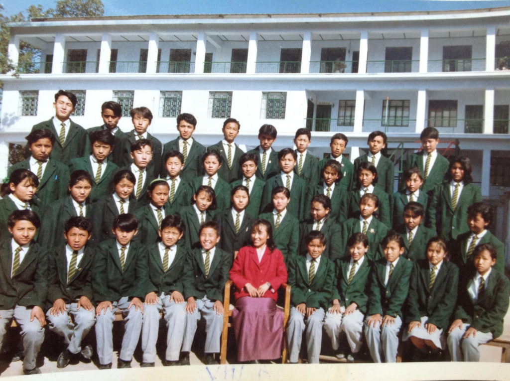 Tashi Thakchoe (seated left side of class teacher) during Class IX Best's photo session at THS Mussoorie, 1994.