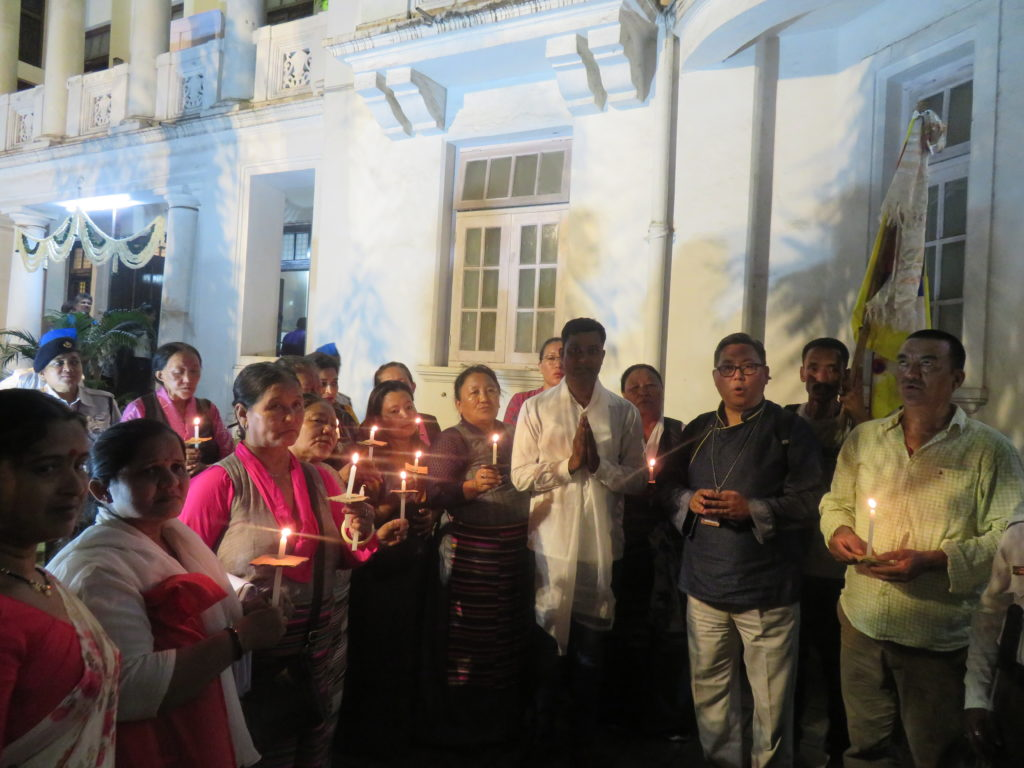 ITCO Coordinator with Mumbai Tibetan Sweater Sellers Association members reciting prayers at Rajgruha. Photo/ITCO