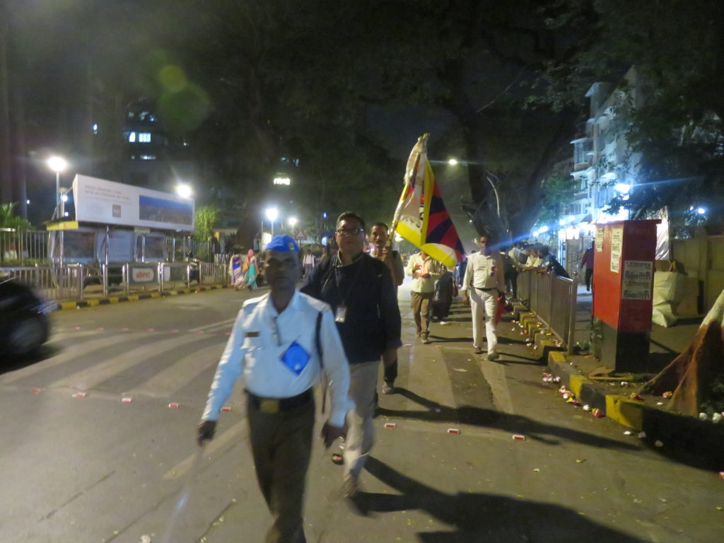ITCO Coordinator and Mumbai Tibetan Sweater Sellers Association members taking out Candle Light Peace March. Photo/ITCO