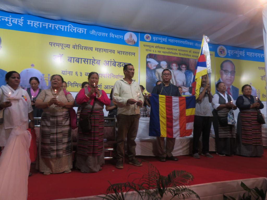 ITCO Coordinator with Mumbai Tibetan Sweater Sellers Association members reciting prayers at Chaityabhumi. Photo/ITCO