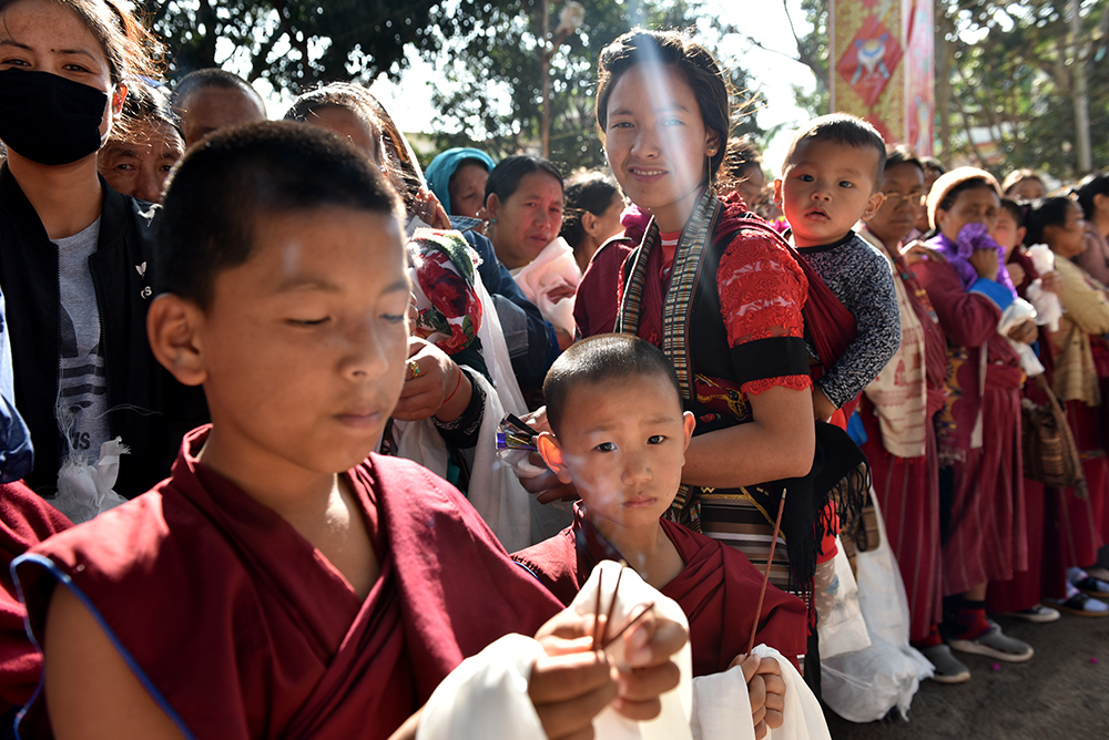 Young monks holding incense offerings as they wait to receive the Dalai Lama. Photo/ Tenzin Jigme