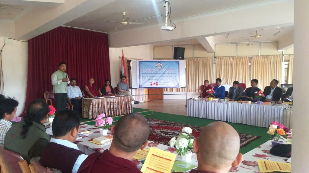 Mr Tenzin Dorjee, Head of Academic Section, DOE addressing the participants at the opening ceremony of the workshop; Special guest, Geshe Tashi Tsering, Abbot of Sera Mey Monastic University, Bylakuppe