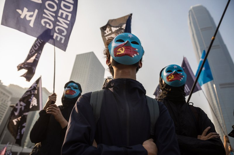 Protesters attend a rally in Hong Kong on December 22, 2019 to show support for the Uighur minority in China. - ong Kong riot police broke up a rally in solidarity with China's Uighurs on December 22 as the city's pro-democracy movement likened their plight to that of the oppressed Muslim minority. (Photo by Dale DE LA REY / AFP) (Photo by DALE DE LA REY/AFP via Getty Images)