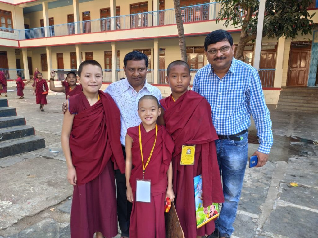 Two members of the group with small monks. Photo/ ITCO, Delhi