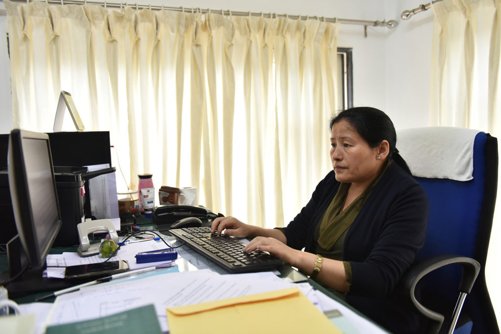 Ms. Tsetan Kalsang at her office, the Tibetan Parliament in Exile.