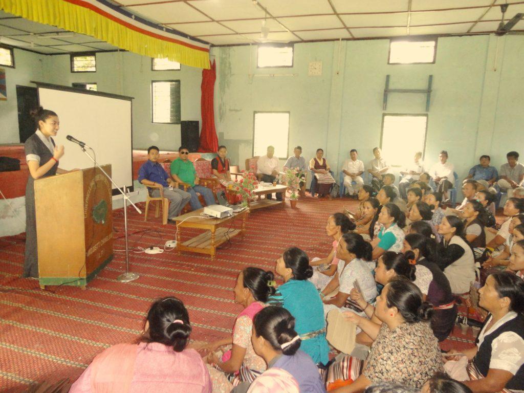 Ngawang Tenzin teaching health education in Miao Tibetan settlement, 2014.
