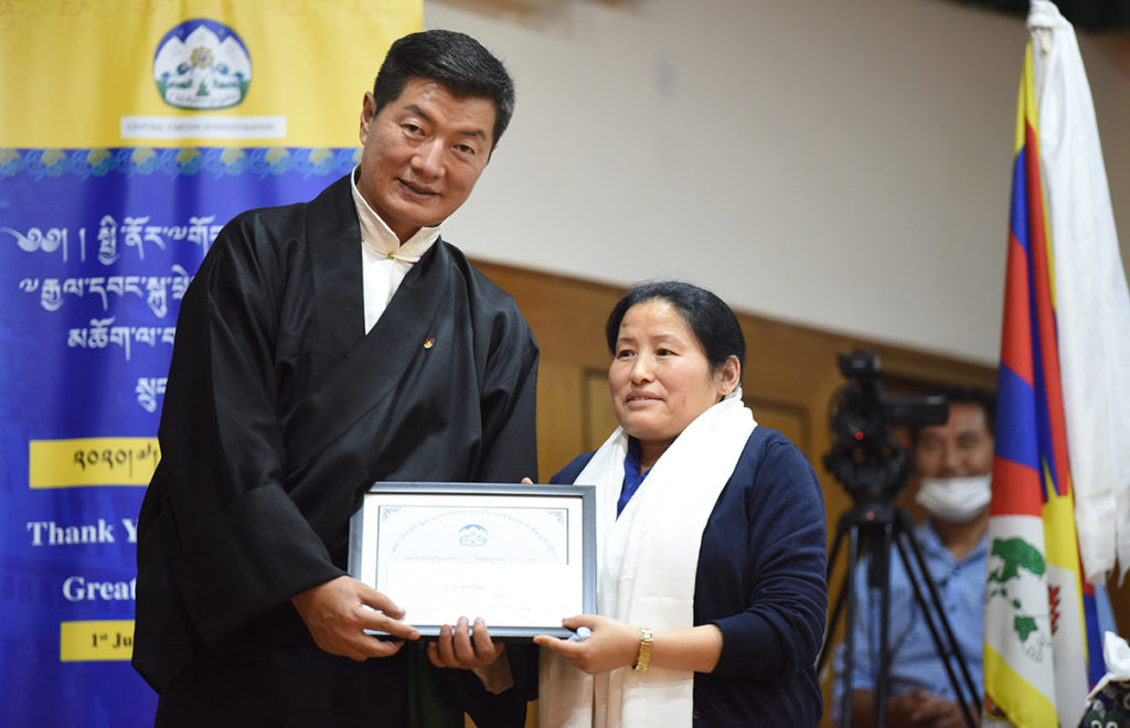 Sikyong Dr. Lobsang Sangay felicitates Ms. Tsetan Kalsang for excellence in service, 6 July 2020. Photo|Tenzin Phende|CTA