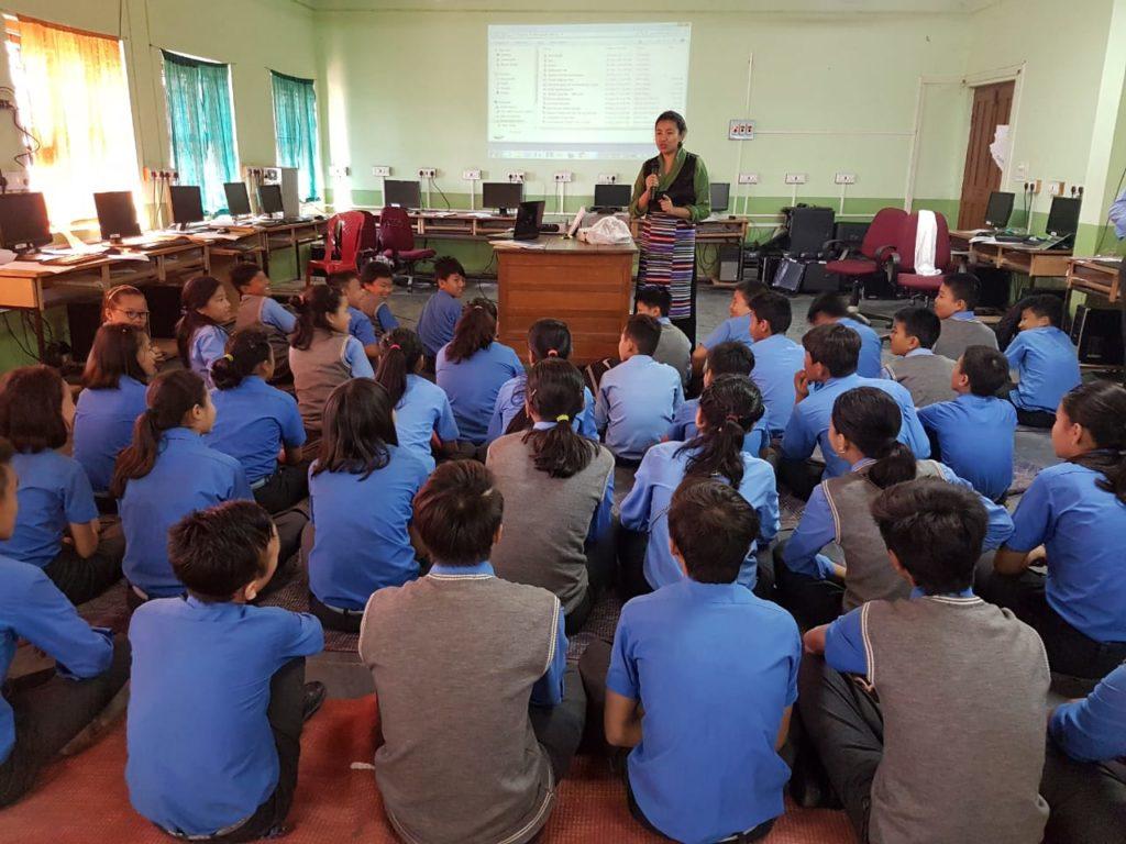 Ngawang Tenzin teaching health education in school, 2019.