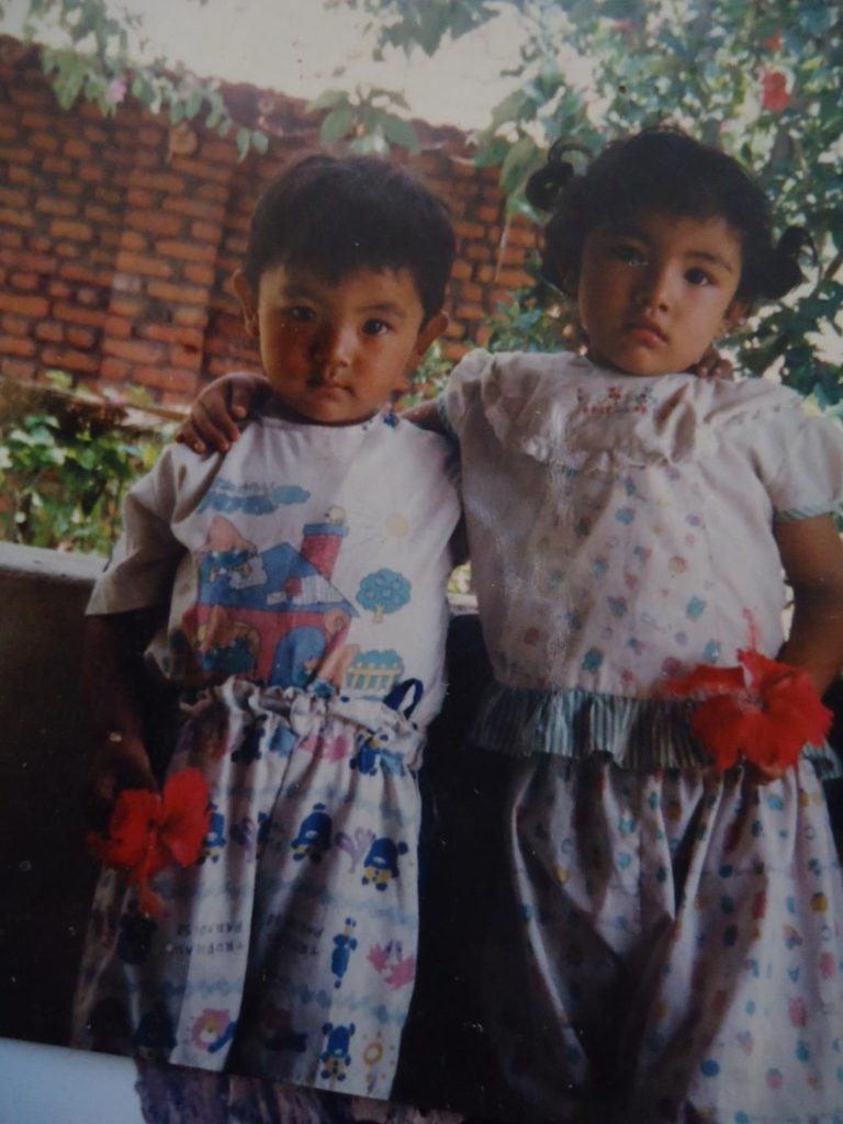 Ngawang Tenzin with her younger brother.
