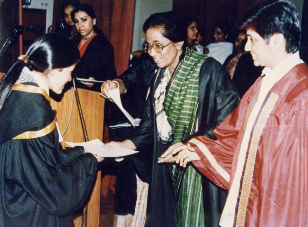 Ms. Tsetan Kalsang receiving a bachelor's degree certificate on the convocation day.