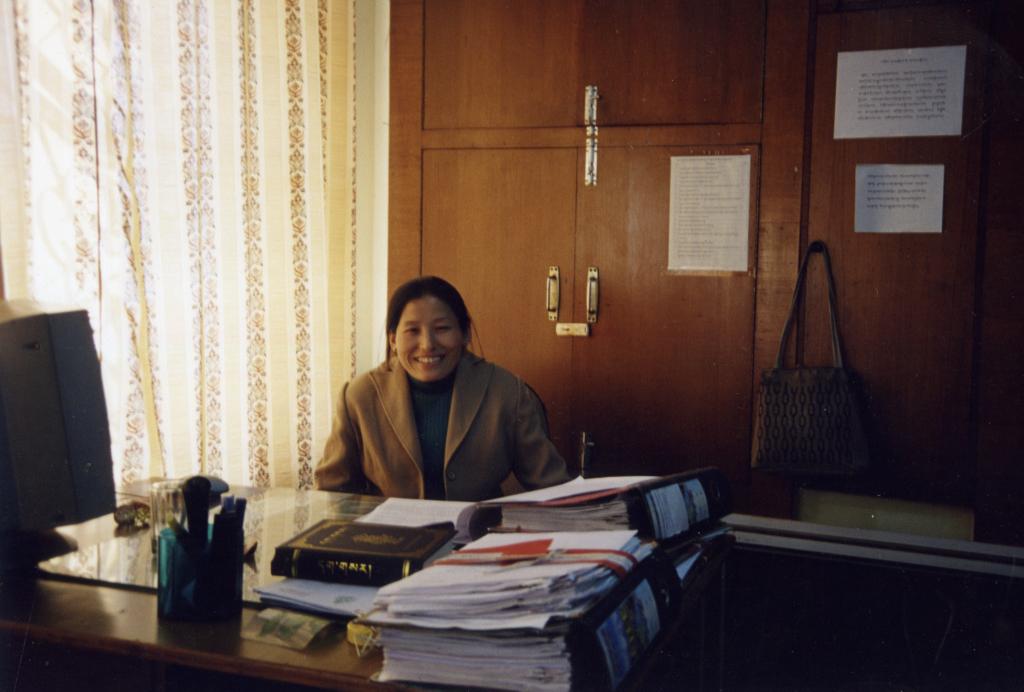 Ms. Tsetan Kalsang at her cabin at the department of Home, CTA.