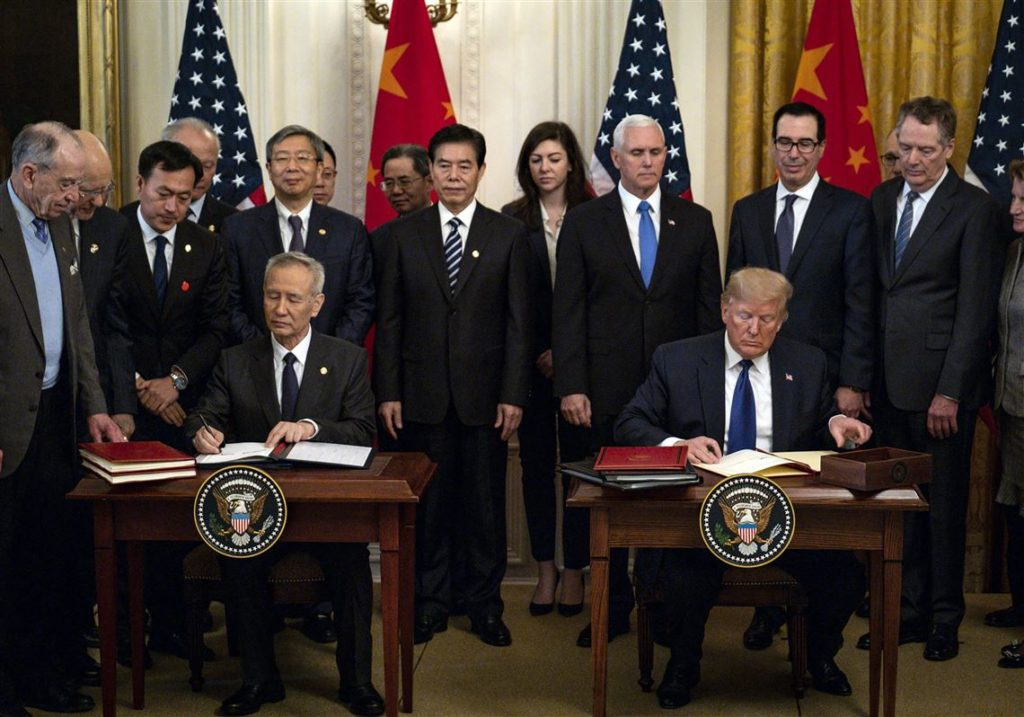 Liu He, China's vice premier, and President Trump signed an initial trade agreement in January at the White House.Credit...Pete Marovich for The New York Times