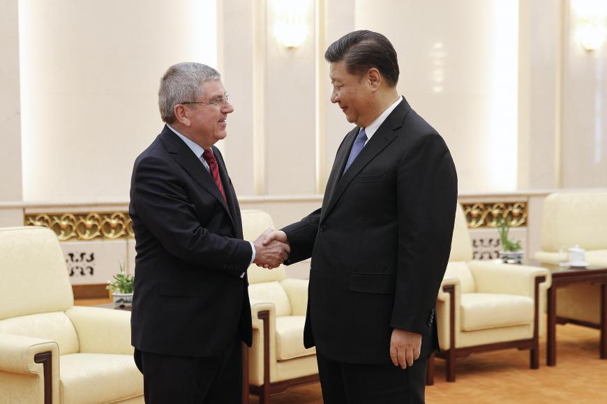 International Olympic Committee President Thomas Bach (left) shakes hands with Chinese President Xi Jinping before proceeding to their meeting at the Great Hall of the People in Beijing, China, January 31, 2019. © 2019 AP Photo/Andy Wong, Pool
