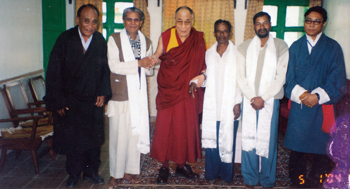 His Holiness the 14th Dalai Lama is flanked by former Home Kalon Kungo Lobsang Nyima, Mr. Palden Dhondup (then Orissa Settlement Officer) and Indian dignitaries, Orissa, 2004.