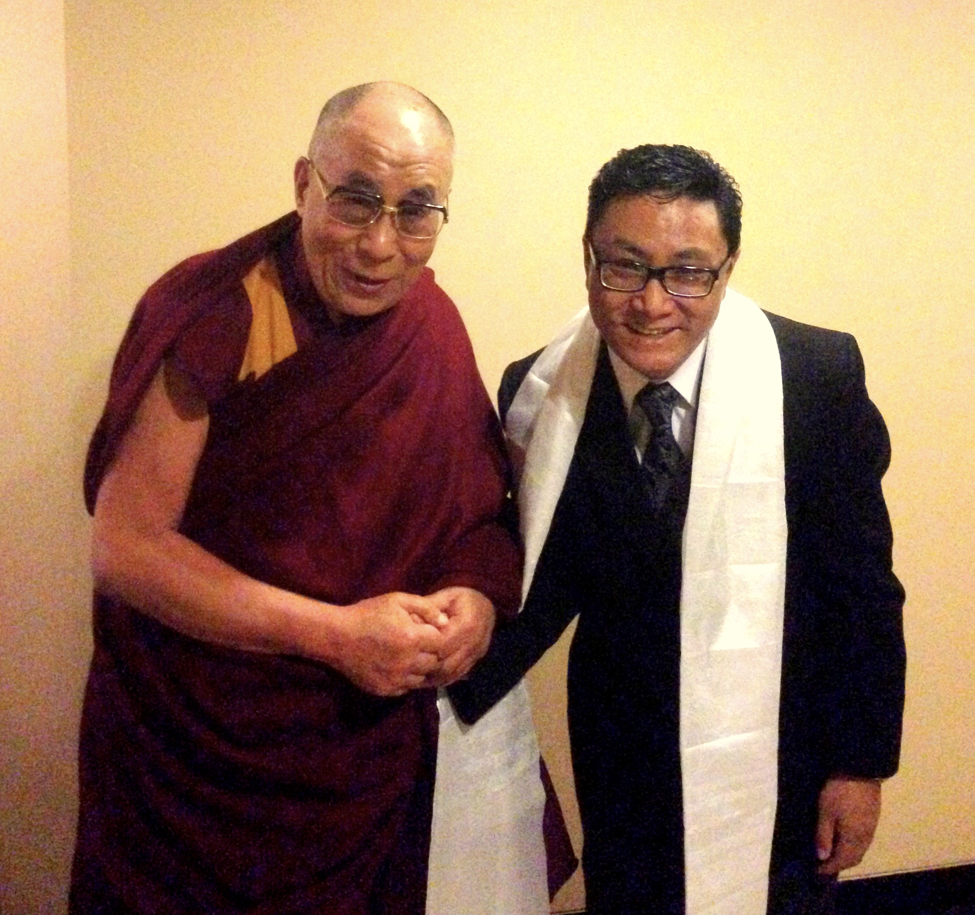 Mr. Palden Dhondup with His Holiness the Great 14th Dalai Lama of Tibet.