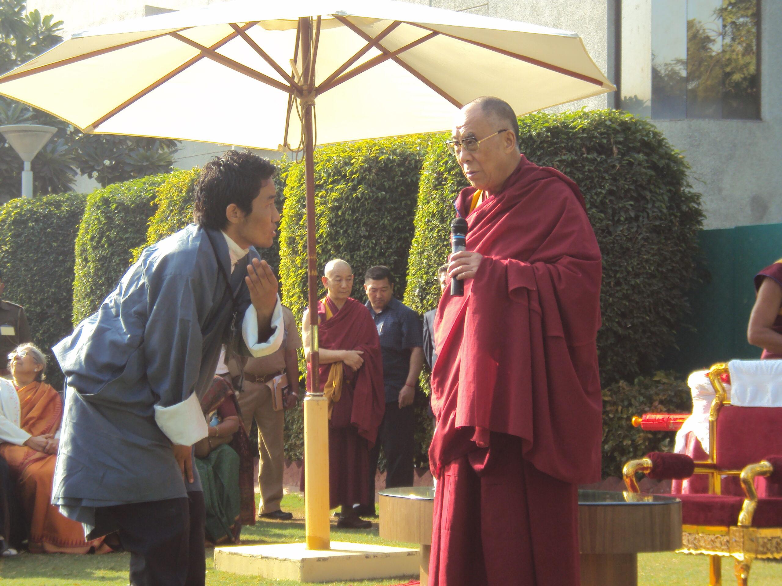 Nyima Gyaltsen, as the president of RTYC Baroda, receives His Holiness the Great 14th Dalai Lama of Tibet, Baroda, Gujarat,2010.