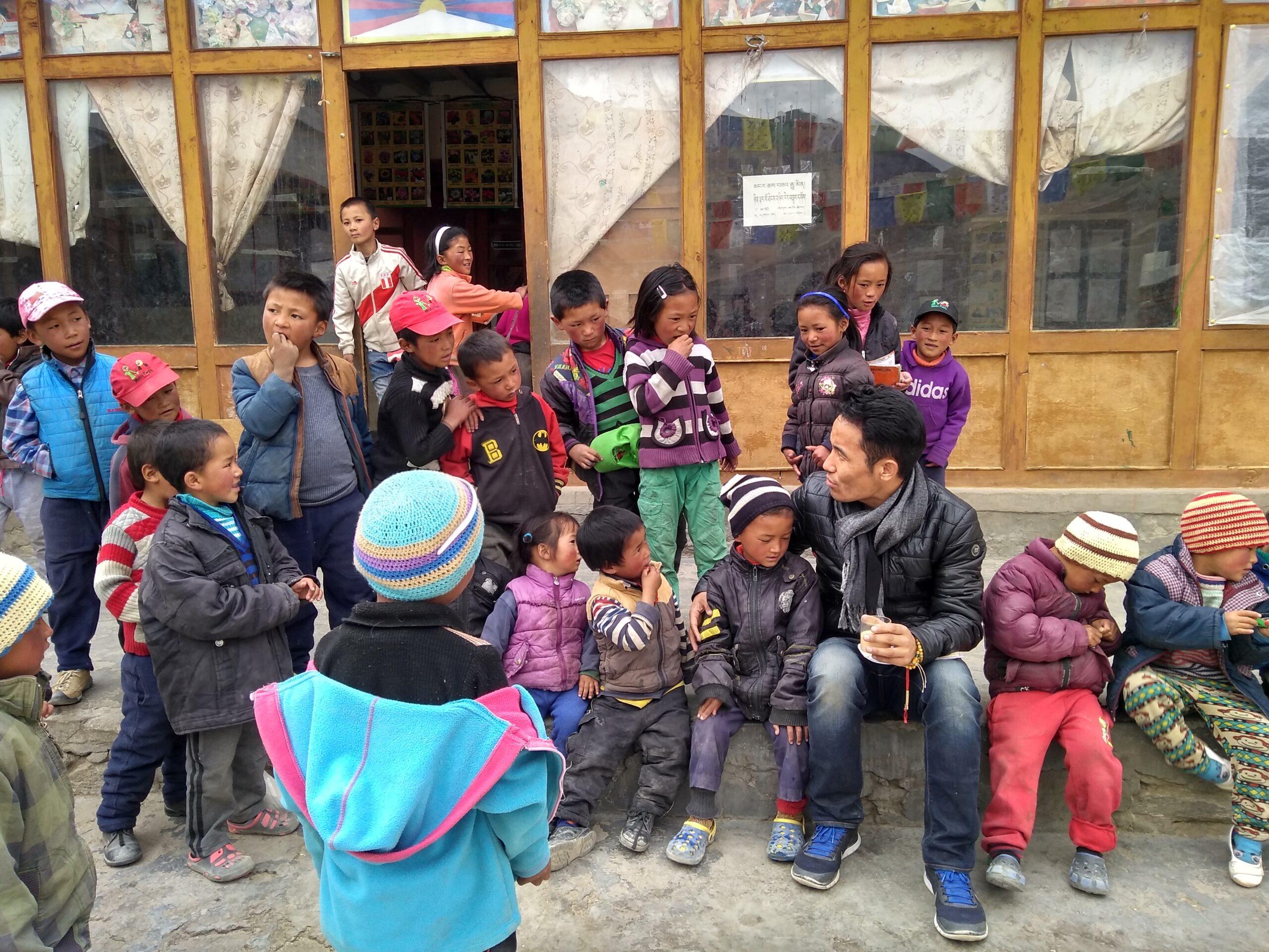 Nyima Gyaltsen with Tibetan children during health assessment program in Tibetan Community in Jangthang, Ladakh, 2018.