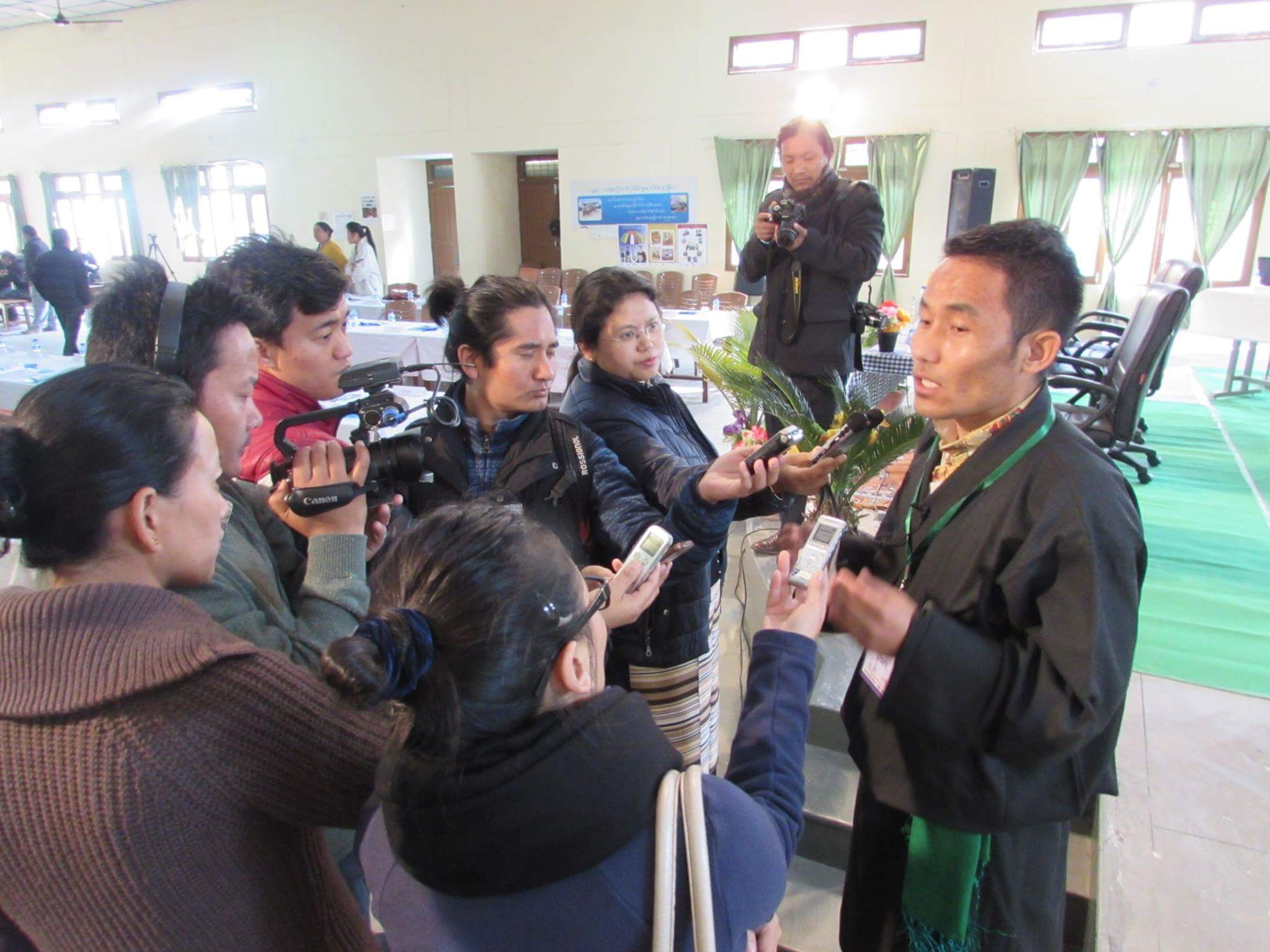Nyima Gyaltsen is seen interacting with media personnels during the Tibetan Medical Support's Annual Workshop and Meeting.