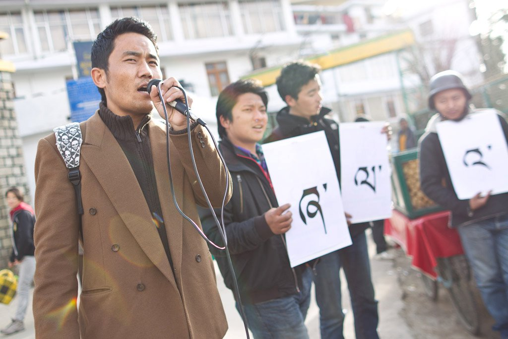Nyima Gyaltsen taking part in street theatre while volunteering with Students for Free Tibet in Dharamshala.